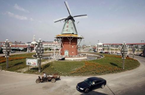 Curiosit olandesi parte dell 39 olanda ricostruita in cina for Affitto bici amsterdam